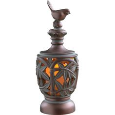 Featuring a botanical openwork design and songbird finial, this lovely flameless candle makes a lovely dining room centerpiece or perfectly complements a nat...