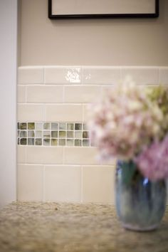 The simplicity of glass mosaics and glossy subway tiles are perfect for this kitchen in a Craftsman style home.