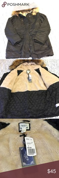 NWT Black Parka with Faux Fur Lining and Hood Gorgeous and warm black parka! Has a fur hood and also fur lining in the chest of the jacket! Perfect for a cold day! Forever 21 Jackets & Coats