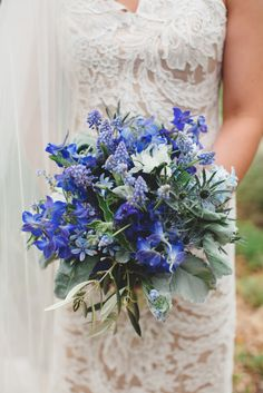 Belladonna Delphinium, muscari, scabiosa, veronica, thistle, and hyacinth in blue tones