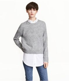 Gray melange. Oversized sweater in a soft, fine knit with wool content. Dropped shoulders, ribbing at neckline, cuffs, and hem, and slightly longer back