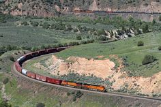 https://flic.kr/p/wVgWx5 | BNSF east of Radium | Traveling Union Pacific's Moffat Tunnel Subdivision, an eastbound BNSF freight snakes along the Colorado River east of Radium, Colorado, on the morning of June 6, 2013. The front of the train is entering Little Gore Canyon, while the rear of the train with two Dash 9s acting as DPUs has just exited 463-foot Tunnel 42 in the background.