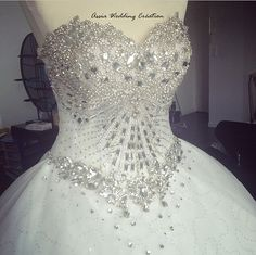 Assia Wedding Création propose handmade wedding dress since 2010 . All is created by us We select the best quality tissue fabric and ornement We are based in France and can ship all around the world This perfect rhinestone dress is our creation in real picture the bust is a real Jewel hand made the train is embroidered with large lace with sequin and Crystal pearl Its the most hight quality wedding dress we have made time to make it : 5 months For world shipping please contact us to be okay…