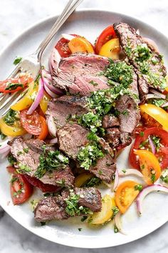 GRILLED SKIRT STEAK WITH CHIMICHURRI. 20 Ketogenic Recipes to Make on the Grill This Summer #purewow #food #grilling #cooking #recipe #grilledrecipes #skirtsteak