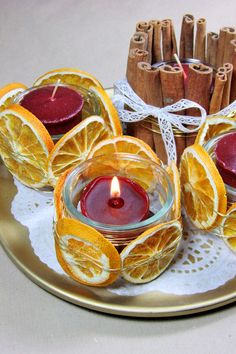 Advent lights - candles, dried oranges, cinnamon sticks and lace