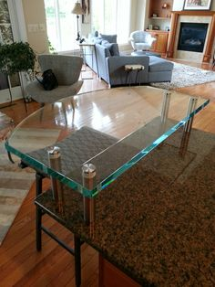 Flat glass countertop in a kitchen to serve as a breakfast bar!