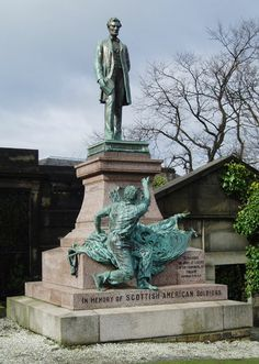 OLD CALTON CEMETERY, Edinburgh. Scottish – American Soldiers Monument[edit]   Scottish–American Soldiers Monument A focal point of the graveyard, just in front of Hume's tomb, this piece of statuary was erected in 1893.[4] It depicts a standing figure of Abraham Lincoln, with a freed slave giving thanks at his feet. A bronze shield bears the old US flag, and is wreathed in thistles to the left, and cotton to the right.