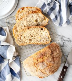 This no-knead bread recipe will make any novice baker look like a pro! It calls for 6 simple ingredients and requires just 5 minutes of work, but it comes out with a perfect golden brown crust and soft interior every time. | Love and Lemons #baking #bread #healthyrecipes