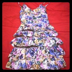 Floral dress Size medium junior. Stretches in back ruffle style. Dresses Mini