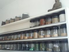 homemade spice rack. Made out of empty peanut butter jars.