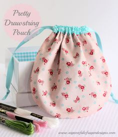 Pretty Drawstring Pouch {Tutorial} | A Spoonful of Sugar  Very cute and easy.