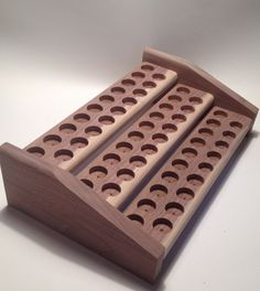 This Handmade Essential Oil Rack is made of Walnut Oak Cedar or Pine and designed to sit on your dresser, counter, or shelf. It is designed to hold 57 bottles. It measures 4 tall, 10