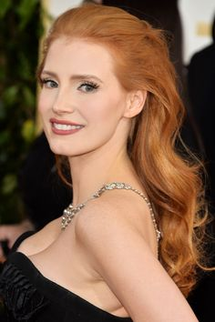 For Jessica Chastain's hair color, ask your stylist for Aloxxi Hair Color Personality ORO BIANCO® | Red Hair | Red Hair Don't Care | Soft Waves | Big Hair | #WhatsYourColorPersonality