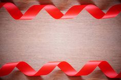 red ribbon on wood can display or montage your products