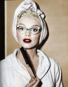 not many pictures of her in glasses. gah she is gorgeous even when she's getting ready