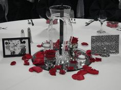 "Wedding reception centerpieces. Red and Black theme. The guest were assigned to their tables with a ""famous couple"". This table was Mickey and Minnie mouse."