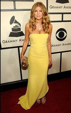 Who made Fergie's yellow strapless long dress that she wore to the Grammy Awards? Dress – Calvin Klein