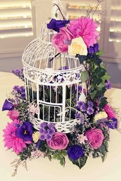 Purple flowers outside birdcage