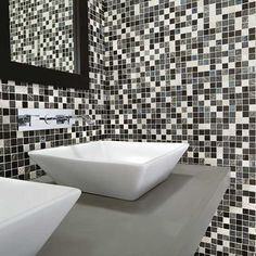 Details: Photo features 1 x 1 Mosaics in Exotic Black on the wall.