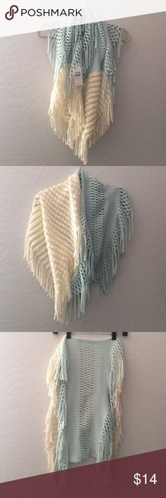 Ivory/Mint Infinity Scarf from Icing NWT. A new infinity scarf from Icing. Ivory/cream on one side and mint with silver on other side. Both sides have fringe. It's beautiful and can be worn so many different ways! Icing Accessories Scarves & Wraps