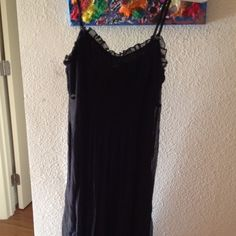 Below the knee if your short, black Lacey dress. Great spring and summer gauzy and lace spaghetti strap dress. New with tags. Not my size anymore. To the Max Dresses