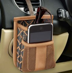 A phone and sunglass holder that hangs from any car air vent. Available at www.highroadorganizers.com