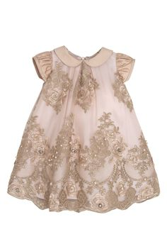 Luxury newborn dress in tulle with preciousembroidery in gold lurex thread with rich floral pattern and pink lining. The whole dress is embellished by a hand-sewn crystals. The collar and the gathered sleeves are made of gold silk shantung