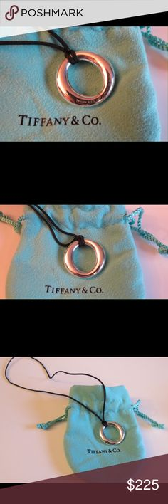 """Tiffany Sevillana Silver Pendant & Black Silk Cord Tiffany Sevillana Silver Pendant On Black Silk Cord     The very cool pendant is Made of solid Sterling silver .925  16"""" Black silk cord  Excellent  gently  used condition. Super on trend!  Includes the authentic pouches as well  All of my items are Guaranteed 100% Genuine I do not sell FAKES of any kind   No Trades (T005) Tiffany & Co. Jewelry"""