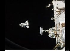Discovery from the ISS The space shuttle Discovery is seen from the International Space Station as the two orbital spacecraft accomplish their relative separation. During a post undocking fly-around, the crew of each vessel photographed the opposing craft. (NASA)