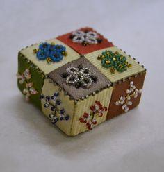 Miniature patchwork pincushionsilk, card, glass beads, pins19th century