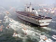 The Royal Navy's last aircraft carriers - the Invincible class - were not officially classed as carriers but as Through Deck Cruisers to escape a round of defence cuts. Three were built - Invincible (seen here returning from the Falklands conflict), Illustrious and Ark Royal. Invincible and Ark Royal were both scrapped along with their complement of Sea Harriers under the current government's defence cuts. Illustrious has been retained as a helicopter carrier but will be scrapped when HMS…