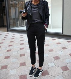 Tux trousers, grey 3/4 sleeve top w/leather shoulders, leather jacket, Nikes.