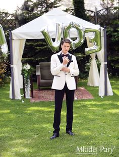 Groom in a white jacket / greenary wedding