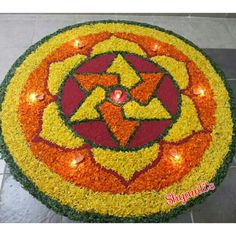 Flower rangoli made using yellow & orange marigold flowers in special occasion of Dasara