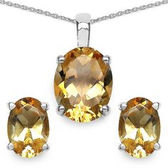 3 bright and happy oval cut citrine gemstones totaling 5.40 carats are prominently displayed in this beautiful sterling silver pendant and earring set. A matching chain that measures approximately 17.