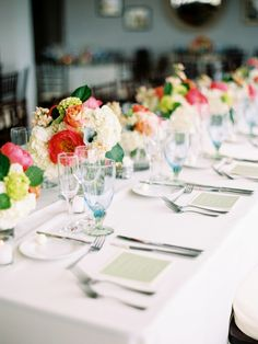 Statement colorful centerpieces on a simple white table| Photography: Lisa Rigby - www.lisarigbyphotography.com
