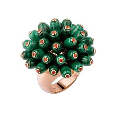 The unique design of this Cartier Paris Nouvelle Vague ring in rose gold, with its writhing and wriggling malachite tubes dotted with fire opals, brings Cartier jewellery bang into the 21st century.