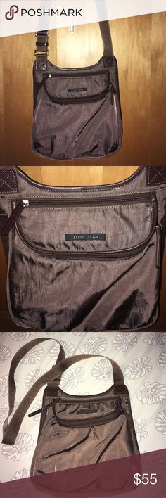 """SALE Elise Tran Brown Cross Body Bag Brown and pink interior Elise Tran cross body bag. Height: 10"""" width: 10"""" depth: 2 1/2"""". Adjustable straps with Elise Tran embroidered into straps. Four different compartments: one in the back pic 4, side spacious compartment pic 8, top compartment pic 6, and front compartment pic 5 & 7. Sadly some stains as shown in pic 7 inside bag. Cute for on the go! elise tran Bags Crossbody Bags"""