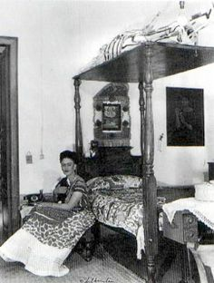 "#fridakahlo Photo by Bernard Silberstein showing ""Juda."" ""In real life Frida did have a papier-mâché skeleton (Juda) on the canopy of her bed. Diego called it ""Frida's lover"" but Frida said it was just an amusing reminder of mortality."