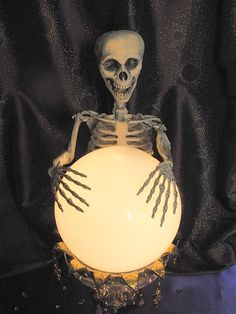 """If you're looking for lots of Halloween decorating ideas to replicate, this is the site for you. This was made from a light fixture ball and an old candy dish, with some other touches. """"Seeing Things: DIY Crystal Ball"""" by geraldine Costume Halloween, Diy Halloween, Table Halloween, Halloween Skeletons, Halloween Projects, Holidays Halloween, Vintage Halloween, Happy Halloween, Halloween Decorations"""