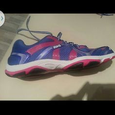 Brand New RYKA Sneakers Blue and dark pink Ryka sneaker. The special sole is made for aerobic dancing such as Zumba. And for Walking . Worn once or twice ! Just look at the soles! Lace up, rubber sole, mesh canvas exterior. Shoes Sneakers