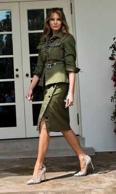 Military style with a twist as Melania walked past the West Wing of the White House in this green skirt suit with black and white trim (and matching heels) on April 27, 2017. Photo: BRENDAN SMIALOWSKI/AFP/Getty Images