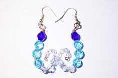 Shades of blue faceted bead curved scorpion tail dangle earrings £4.00