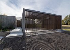 Board-marked concrete walls, wooden screens and secluded courtyards feature in…