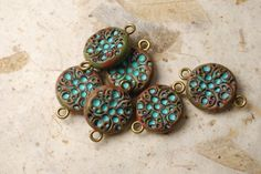 Set of six rustic polymer clay beads or components with turquoise bubble patterns. From The Blue Bottle Tree.
