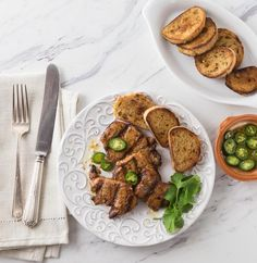 How to make a classic Spanish tapas dish: Prueba de cerdo. How about a classic Spanish tapas dish! Spicy marinated pork tenderloin medallions in paprika marinade and flash grilled al la plancha or al carbon. | ethnicspoon.com
