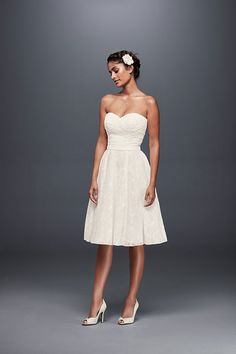 A simple short wedding dress with flattering details, from the pleated sweetheart bodice to the flowing knee-length skirt. Exclusively at David's Bridal.