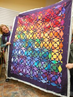 Miriam's colorful Fluid Transitions (sba modern quilting guild).  A lovely Storm at Sea quilt.