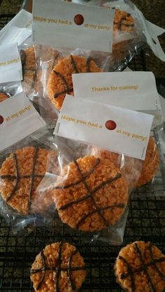 Basketball Rice Krispy treats. Round cookie cutter and melted chocolate. Bag topper template can be found at Avery.com. I coated the bag topper with mode podge for durability