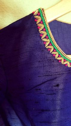 Royal Highness - Striking blue high neck blouse Royal blue : Color Princess cut high neck blouse with multicolored floral hand embroidery for sleeves and neck. Back hooks Brocade Blouse Designs, Kids Blouse Designs, Simple Blouse Designs, Blouse Neck Designs, Blouse Simple, Hand Designs, Simple Designs, Hand Work Design, Hand Work Blouse Design